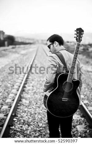 Lone handsome male musician on his way - stock photo