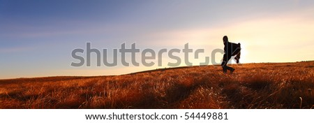 Lone hiker in wilderness - stock photo
