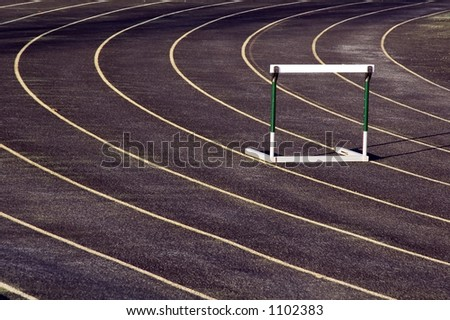 Lone hurdle on an outdoor track - stock photo