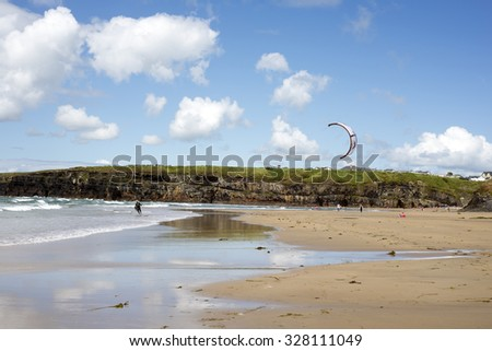 lone kite surfer getting ready at ballybunion beach on the wild atlantic way - stock photo