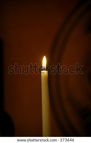 lone lit candle - stock photo
