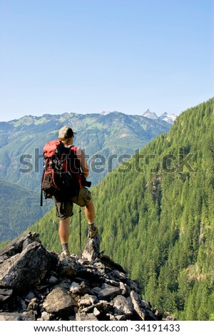 lone male backpacker - stock photo