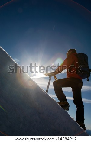Lone male mountain climber climbing a snowy ridge; Mont Blanc, Europe. - stock photo