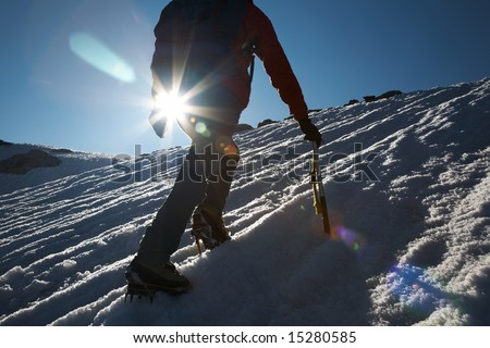 Lone male mountain climber climbing a snowy ridge; Mont Blanc, Europe. - stock photo