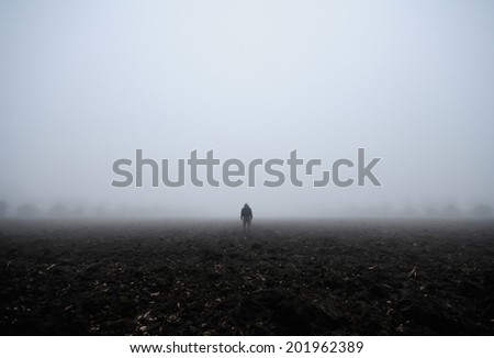 Lone man in the fog  - stock photo