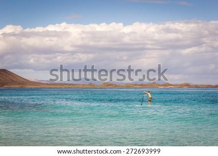 Lone Paddleboarder - stock photo