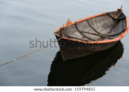 Lone rowing boat - stock photo