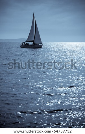 Lone sailing - stock photo