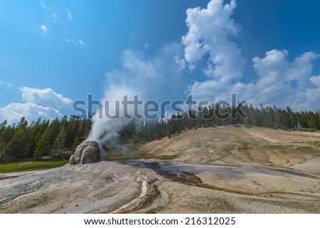 Lone Star Geyser during eruption Yellowstone National Park - stock photo