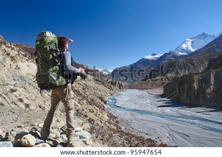 Lone trekker  looking on mountains - stock photo