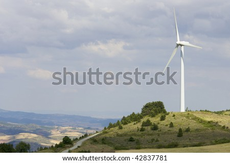 lone windmill on a hill - stock photo