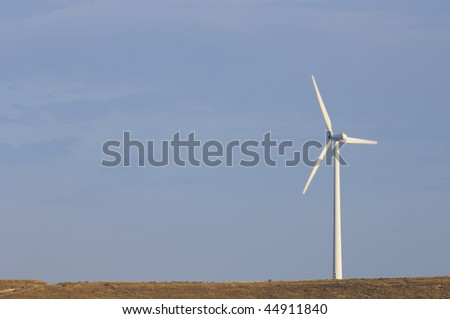lone windmill with blue sky
