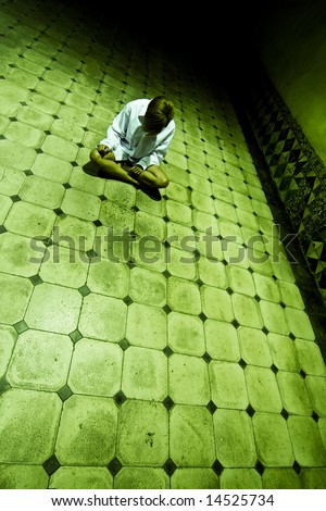 Lone woman in spooky corridor - stock photo