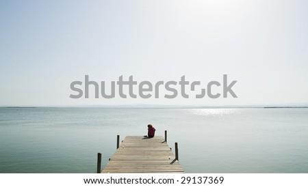 Lone woman in the lake. - stock photo