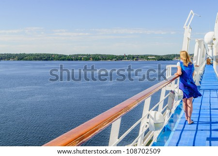 lone woman views islands from a cruise ship in archipelago, off Stockholm , Sweden - stock photo
