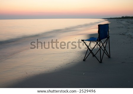 Loneliness camp-chair on the sea shore at the time of sunshine