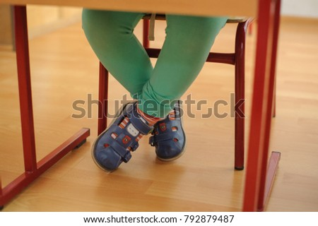 Loneliness School Childs Legs Under Table Stock Photo Download Now