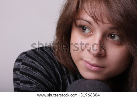 loneliness or thinking young woman - stock photo