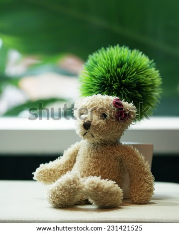 Loneliness teddy bear red bow on head - stock photo