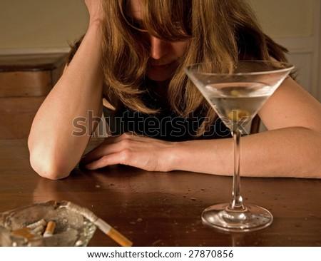 lonely alcoholic woman sobbing - stock photo