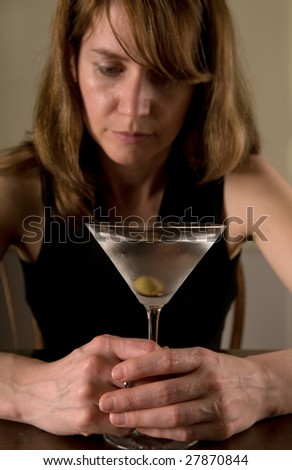 lonely alcoholic woman, with martini