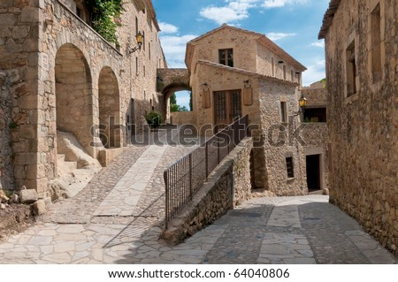 Lonely alley in Peratallada, Spain - stock photo