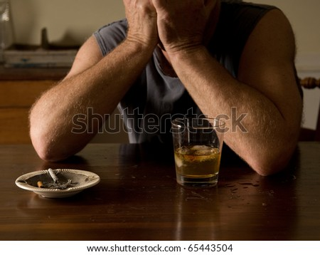 lonely and desperate - portrait of middle-aged man with addiction problems - stock photo