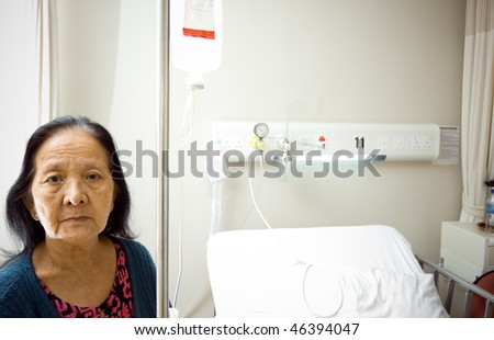 lonely asian old woman get infusion during inpatient treatment at the hospital - stock photo