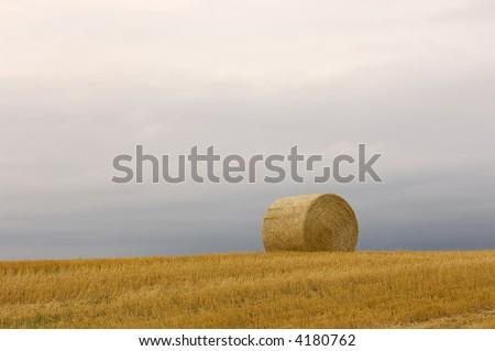 Lonely Bale of Hay near Dickinson, North Dakota - stock photo