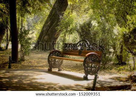 Lonely bench in the park - stock photo