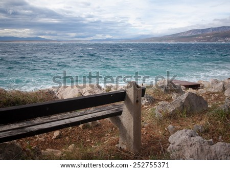 lonely bench looking into the sea waiting for somebody, krk, croatia - stock photo