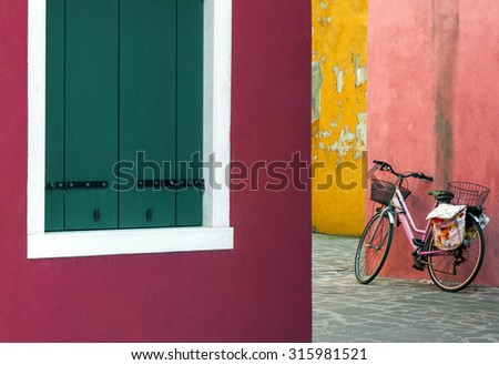 Lonely bicycle in the colorful street of island Burano, Venice - stock photo