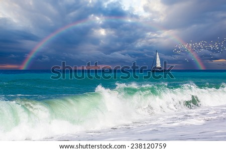 lonely boat against rainbow  - stock photo