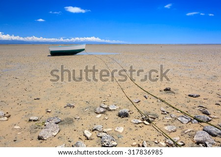 Lonely boat during low tide in Nelson, New Zealand - stock photo