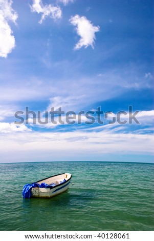 Lonely boat in the tropical sea