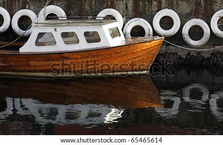 Lonely boat near a mooring - stock photo