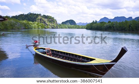 Lonely Boat, Phang Nga Bay National Park, Thailand - stock photo