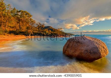 Lonely boulder on sunset, Honeymoon Bay, Freycinet Peninsula, Tasmania - stock photo