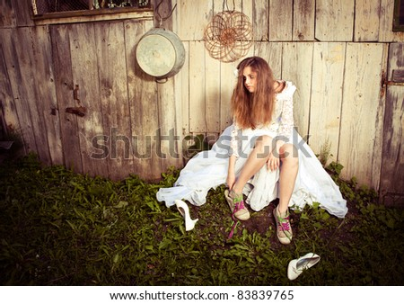 Lonely bride at one with their life problems - stock photo