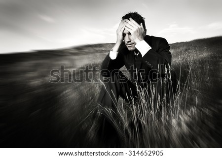 Lonely businessman depressed about life Stress Concept - stock photo