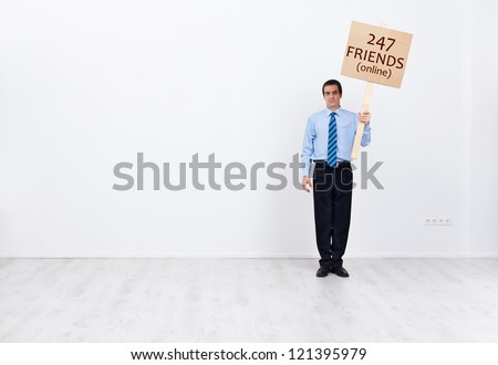 Lonely businessman with lots of online friends - social life and technology concept - stock photo