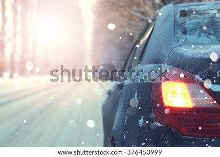lonely car road trees winter sunset - stock photo