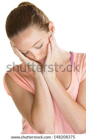 Lonely Caucasian woman holding her face in her hands