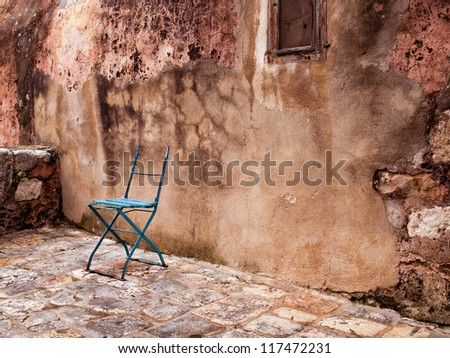 Lonely chair against the wall in Israel