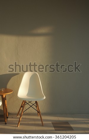Lonely chair with sunlight. Home Interior. - stock photo