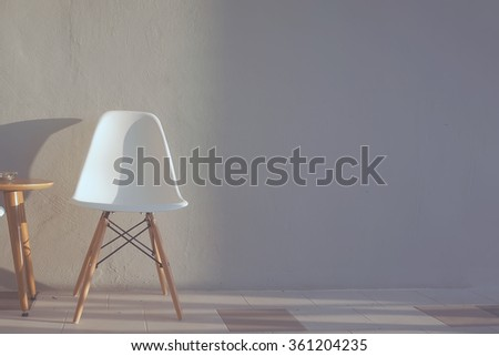 Lonely chair with sunlight. Home Interior. Fade tone. - stock photo