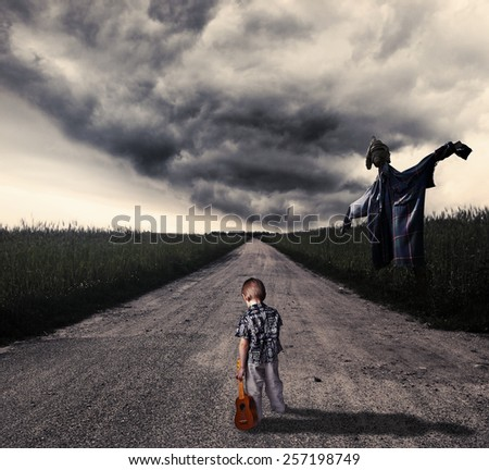 Lonely child reaching the dangerous road - stock photo