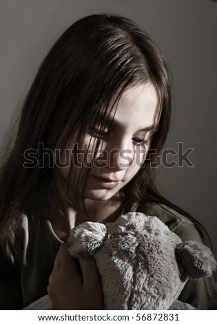 Lonely child with toy - stock photo