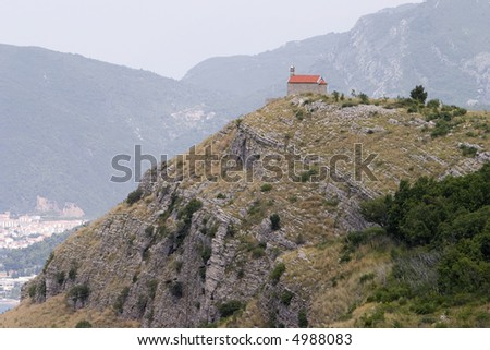 Lonely Church On Mountain. A small, one room church is located right at the edge of a rocky promontory on the Montenegro coast near Vrba and Sveti Stefan.