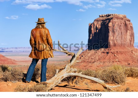 lonely cowgirl at Monument Valley, Utah, USA - stock photo